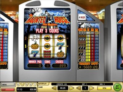 Main game board featuring three reels and 3 paylines with a $10,000 max payout